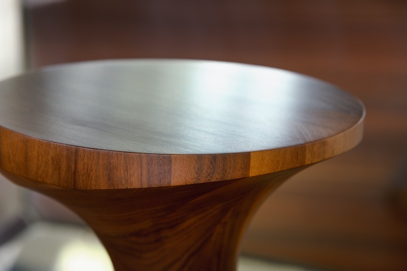 Sculptural wooden stool made by Anew from American Black Walnut